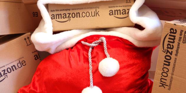 Antwerpen, Belgium - February 25, 2014: Santa's bag filled with Amazon.eu boxes. Amazon is the world's largest online retailer.