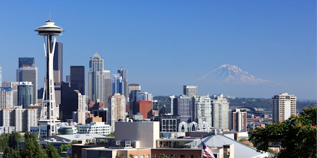 "Downtown Seattle with Mount Rainier looming in the background. Foreign buyers are flocking to the city at a ""frenetic"" pace, thanks in part to the foreign buyer's tax in the Vancouver area."