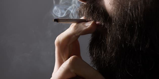 A man is seen smoking a joint.
