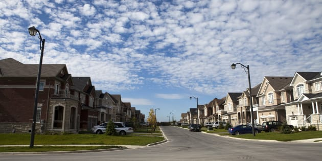 Canada's national housing agency says new regulations introduced last fall decreased the size of the country's insured mortgage market by about 33 per cent year-over-year in the second quarter.