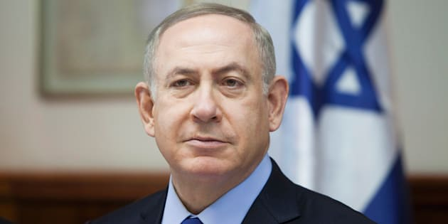 Israeli Prime Minister Benjamin Netanyahu chairs the weekly cabinet meeting in Jerusalem on December 25, 2016. Israel was defiant over a UN vote demanding it halt settlements in Palestinian territory, after lashing out at U.S. President Barack Obama over the 'shameful' resolution. (DAN BALILTY/AFP/Getty Images)