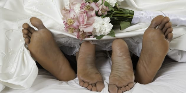 An Afro American couple make love on their wedding nightPeople images