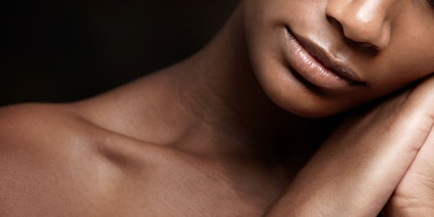 Cropped image of an african beauty with flawless skin sleeping against a black background