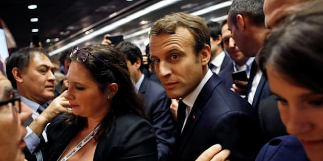 French President Emmanuel Macron (C) talks with people at a building trade congress in Paris, France, October 6, 2017. REUTERS/Thibault Camus/Pool