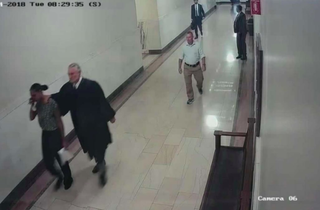 Judge resigns after video shows him grabbing black woman