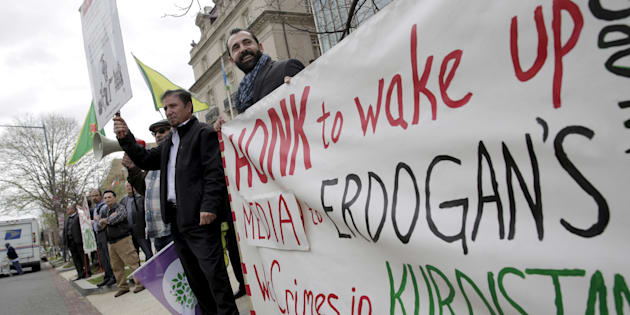 Protesters rally in front of the Brookings Institute before the arrival of Turkish President Recep Tayyip Erdogan in Washington, March 31, 2016.