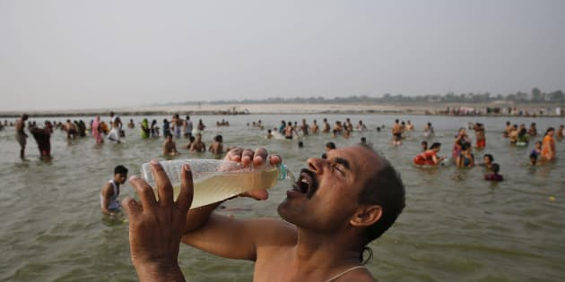 A man drinks water from the Ganga during the Ganga Dussehra festival in Allahabad, June 8, 2014. (AP Photo/Rajesh Kumar Singh)