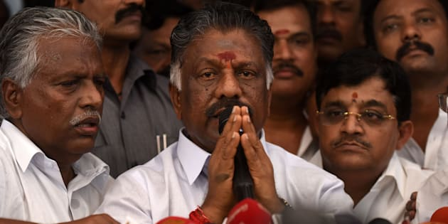 Acting chief minister O Panneerselvam (C) of the southern Indian state of Tamil Nadu gestures during a press conference at his home in Chennai on February 14, 2017.