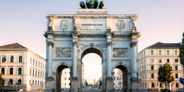 Siegestor triumphal arch in Munich, Germany at dusk.