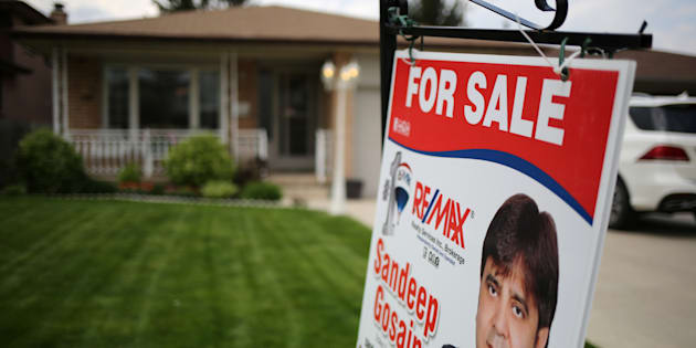 """A house for sale through a realtor in Hamilton, Ont., May 13, 2017. The head of the Ontario Real Estate Association says the recent changes to housing rules across Canada amount to a """"war on first-time homebuyers."""""""