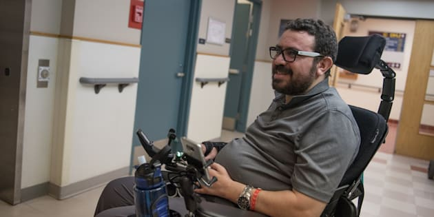 Aymen Derbali, 41, a victim of the Quebec City mosque attack, talks following rehabilitation exercises on Jan. 25, 2018 in Quebec City.