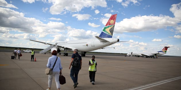 Passengers board an SAA aircraft at the Hosea Kutako International Airport outside Windhoek in Namibia.
