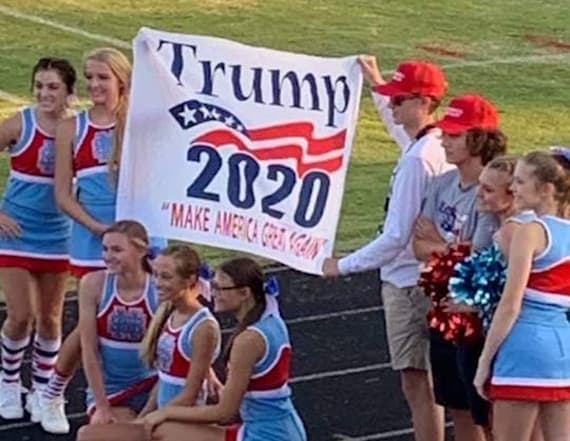 Girls put 'on probation' after posing with banner