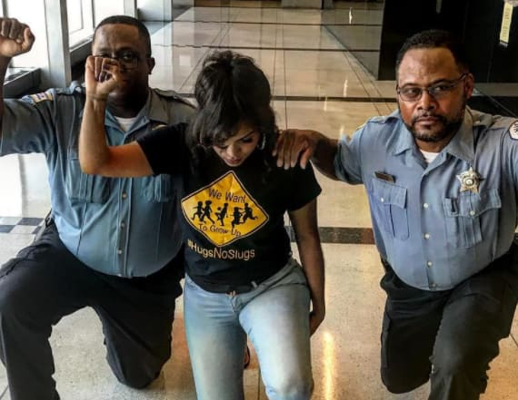 Cops reprimanded for kneeling in viral photo