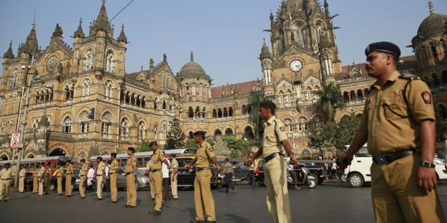 Indian policemen stand guard outside the Chhatrapati Shivaji train station, one of the sites of the 2008 terror attack.