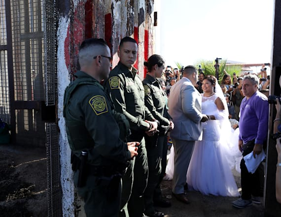 Hugs, tears and a wedding at US-Mexico border wall