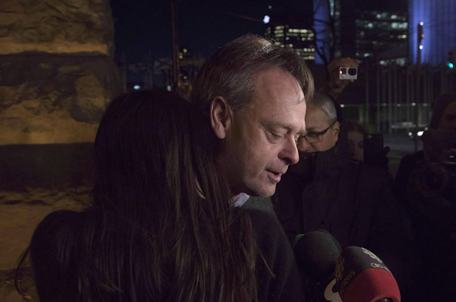 Marc Emery hugs his wife, Jodie, outside a Toronto court after being released on bail on March 10, 2017. He had pleaded guilty to trafficking cannabis, stemming from the opening of a Cannabis Culture boutique in Montreal.