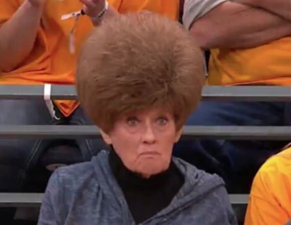 Basketball fans distracted by woman's hair