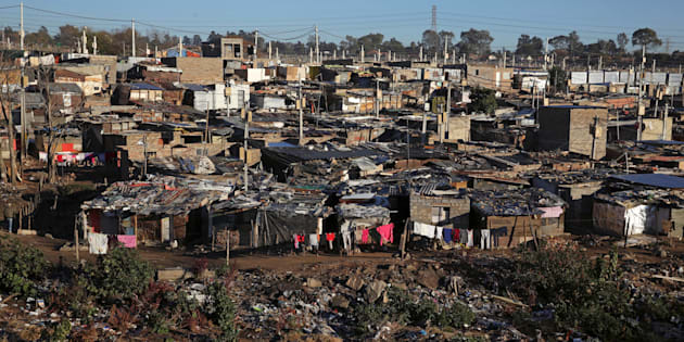 A general view shows Alexandra township, an informal settlement for thousands of South Africans who lack the means to get a proper home, located near the upper-class suburb of Sandton in Johannesburg,.