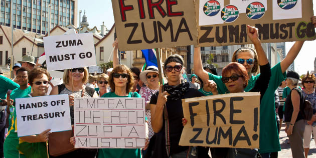 Protestors hold up placards reading 'Fire Zuma' during a demonstration of supporters of the Save South Africa (SaveSA) campaign, civil society organisations and political parties demanding South African President Jacob Zuma to resign on April 4, 2017 in Port Elizabeth.