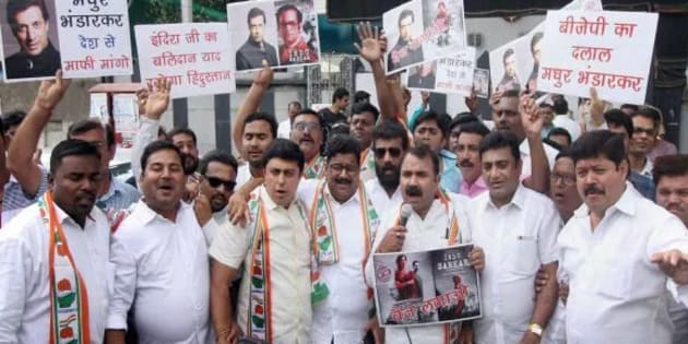 """Congress party workers hold placards against Bollywood director Madhur Bhandarkar to protest against his upcoming film """"Indu Sarkar"""" in Nagpur on Sunday."""
