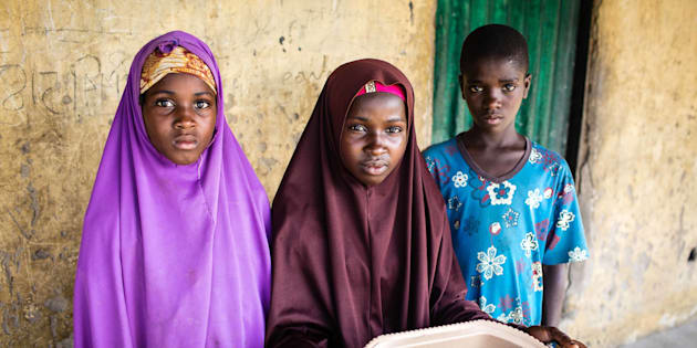 Zulyatu (center), 16, and her younger siblings rarely have enough to eat. Their father died during a Boko Haram raid and their mother left to seek health care from a healer.