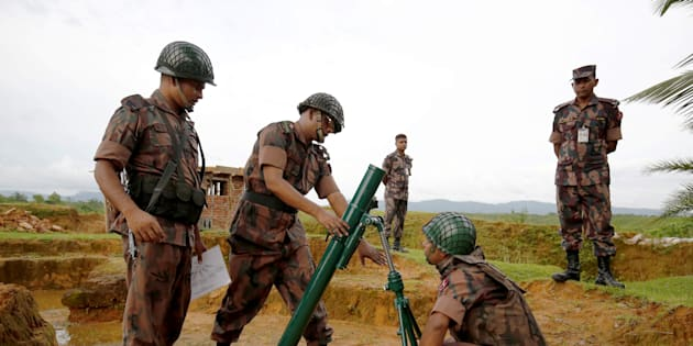 Members of Border Guard Bangladesh (BGB) prepare a mortar as a part their defence after heavy gunshots are being heard at the Myannmar side in Cox?s Bazar, Bangladesh, August 26, 2017. REUTERS/Mohammad Ponir Hossain