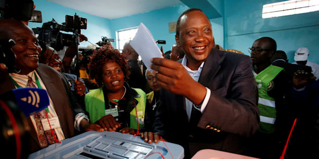 Kenya's President Uhuru Kenyatta casts his ballot inside a polling station in his hometown of Gatundu in Kiambu county, Kenya August 8, 2017. REUTERS/Baz Ratner     TPX IMAGES OF THE DAY