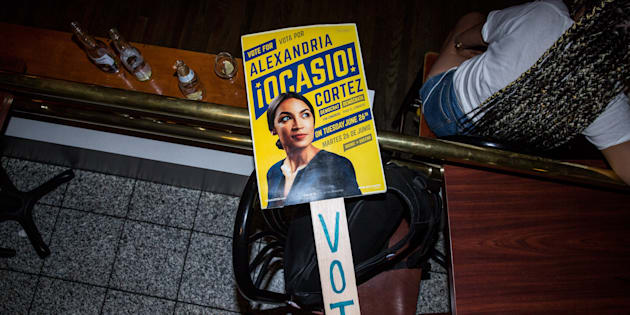 NEW YORK, NY - JUNE 26: A sign for progressive challenger Alexandria Ocasio-Cortez at her victory party in the Bronx after an upset against incumbent Democratic Representative Joseph Crowly on June 26, 2018 in New York City. Ocasio-Cortez upset Rep. Joseph Crowley in New York?s 14th Congressional District, which includes parts of the Bronx and Queens. (Photo by Scott Heins/Getty Images)