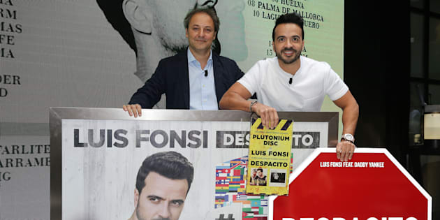 Luis Fonsi (R) presents his 'Love + Dance World Tour' and receives an award from the hands of Narcis Rebollo for 'Despacito' on June 30, 2017 in Madrid.