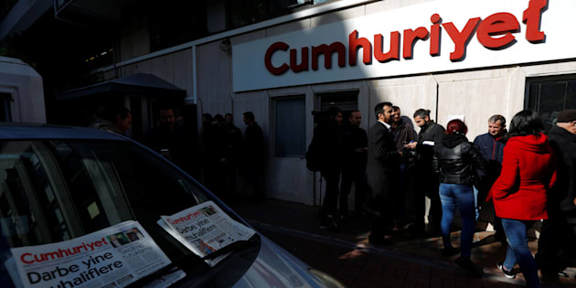 Journalists stand in front of the headquarters of Cumhuriyet newspaper, an opposition secularist daily, in Istanbul, Turkey, October 31, 2016. REUTERS/Murad Sezer