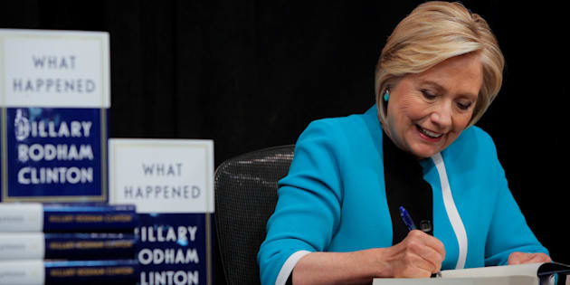 Former U.S. Secretary of State Hillary Clinton signs a copy of her new book 'What Happened' at Barnes & Noble bookstore at Union Square in New York City, U.S. on Sept. 12, 2017.