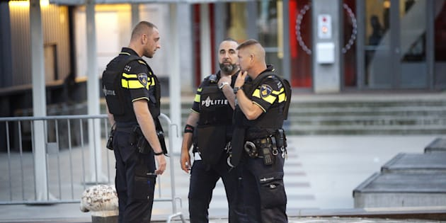 Police stand during the evacuation of the venue.