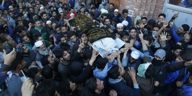 Kashmiri villagers carry the body of Uzair Mushtaq during his funeral in Kulgam 75 Kilometers south of Srinagar, Indian controlled Kashmir, Sunday, Oct. 21, 2018. Three local rebels were killed in a gunbattle with Indian government forces in disputed Kashmir on Sunday, and six civilians were killed in an explosion at the site after the fighting was over, officials and residents said. (AP Photo/Mukhtar Khan)