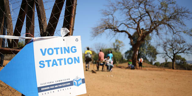 Locals are seen outside a polling station during tense local munincipal elections in Vuwani, South Africa's northern Limpopo province, August 3, 2016.