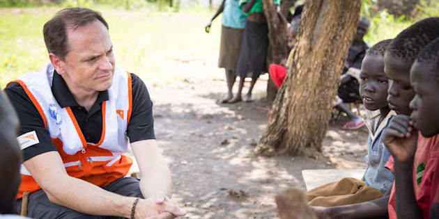 World Vision President Michael Messenger listens to the stories of refugee families.