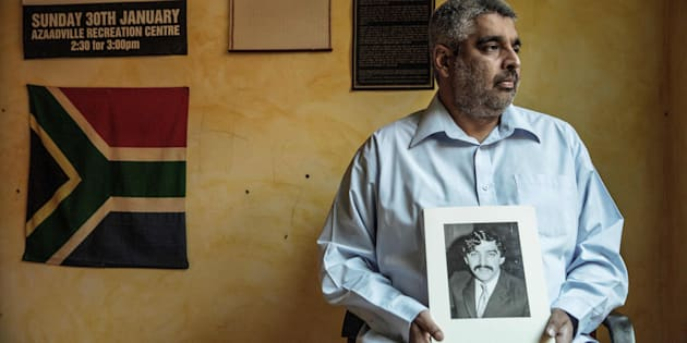 Imtiaz Cajee, the nephew of Ahmed Timol, an anti-apartheid activist brutally murdered in police custody in October 1971, holds a portrait of his uncle at his house on May 25, 2017, in Pretoria.