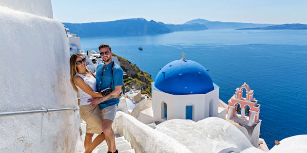 Young couple walking on the island of Santorini, Greece