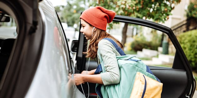 Teen getting on car