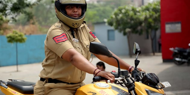 NEW DELHI- INDIA - JUNE 8: A lady policewoman on bike deployed at Delhi University North Campus on June 8, 2018 in New Delhi, India. With aim of ensuring women safety during admission process Delhi police has deployed 40 Policewomen in North Campus. The women cops will patrol area with bikes and PCR Vans. (Photo by Amal Ks/Hindustan Times)