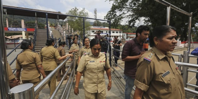 Police women above the age of 50, who have been deployed for security, return after worshipping at the Sabarimala temple.
