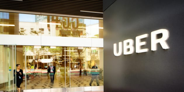 Uber headquarters entrance in San Francisco with sign on the right.