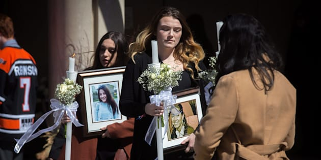 Funeral-goers exit the funeral for triple homicide victims Krassimira, Roy, and Venallia Pejcinovski of Ajax at the St. Demetrios Greek Orthodox Church in Toronto on Saturday, March 24, 2018.