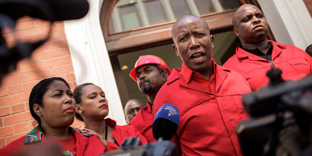 EFF leader Julius Malema (2R) talks to the press after staging a walk out during the election by the Members of Parliament of the new South African President on February 15, 2018 in Cape Town.
