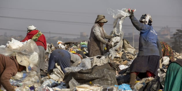 Waste pickers sort through garbage for recycling at a dumpsite in Sasolburg, South Africa.