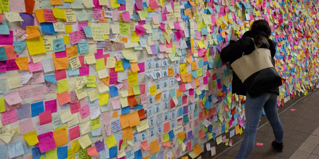 New Yorkers shocked and angered by the unexpected election of Donald Trump as President leave messages on colored note paper on the wall of the Union Square subway station in Manhattan on November 22, 2016.