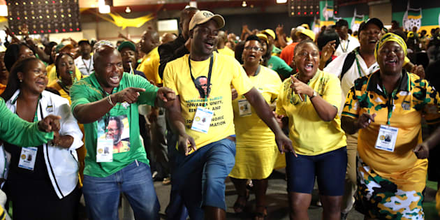 ANC members celebrate after Cyril Ramaphosa was elected president of the ANC during the 54th National Conference of the ruling ANC at the Nasrec Expo Centre in Johannesburg, South Africa December 18, 2017.