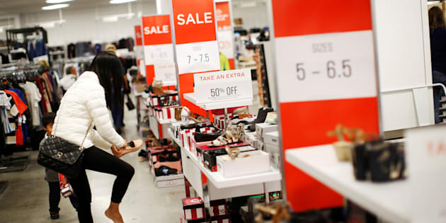 A woman tries on shoes at a Sears store in Oakville, Ontario, Canada, October 6, 2017.