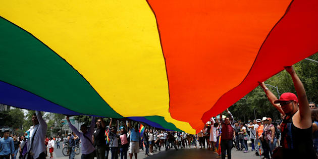 Participants carry a rainbow flag during the Gay Pride Parade in Mexico City last week.