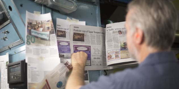 Foreman John Shamrock checks the color on a page of newspaper while printing the daily edition of The Columbian on April 18, 2018 in Vancouver, Washington. Members of the U.S. Congress are warning that newspapers in their home states are in danger of cutting coverage or going out of business if the U.S. maintains recently imposed tariffs on Canadian newsprint.